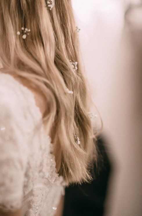 wedding hairstyle with tiny flowers